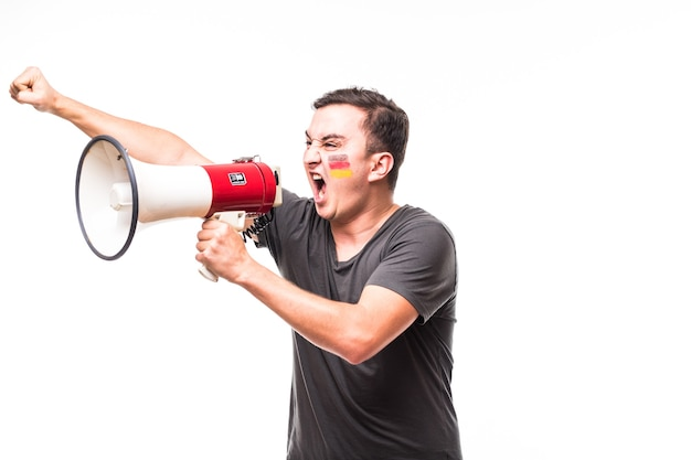 Scream on megaphone germany football fan in game supporting of germany national team on white background. football fans concept.