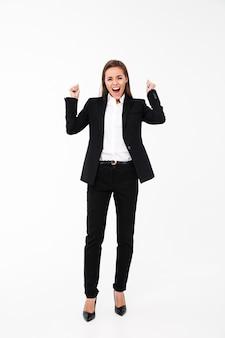 Screaming businesswoman make winner gesture