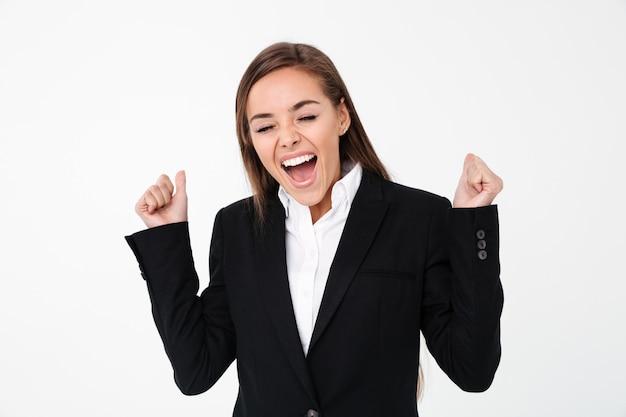 孤立した立っている興奮しているビジネス女性の叫び