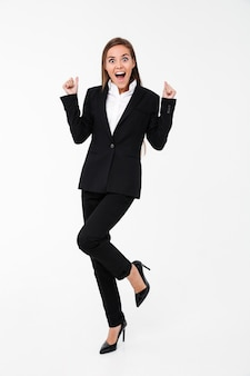 Screaming excited business woman standing isolated