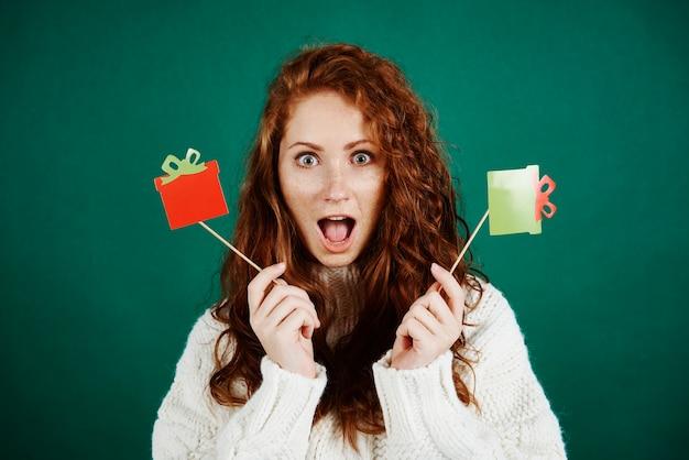 Screaming girl with christmas mask at studio shot