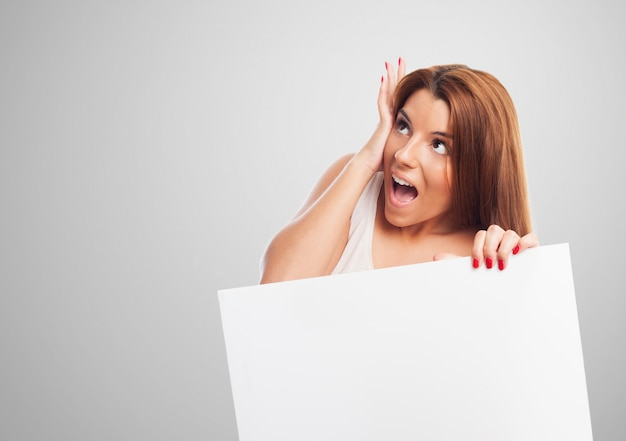 Screaming woman holding a panel