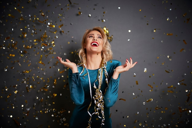 Screaming woman under shower of confetti