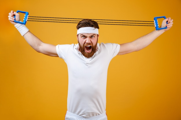 Screaming young sportsman make sport exercises