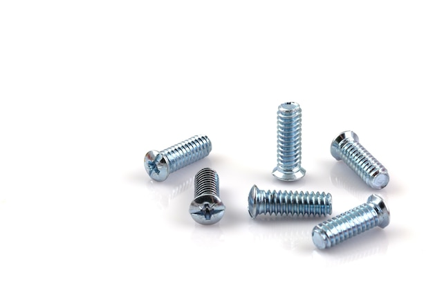 Screwed screws nuts against isolated on white background