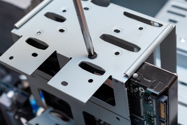 Screwing installing upgrading hdd drive disk on a place in the service