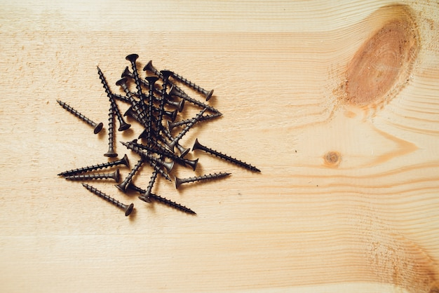 Screws for fastening of wooden boards