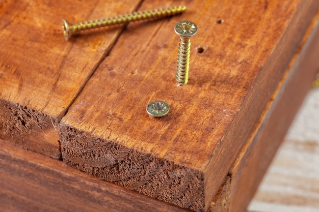 Screws on a wooden table