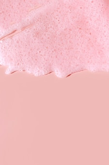 Scrub  smear on a pink background. beauty texture. sample of a cosmetic product.