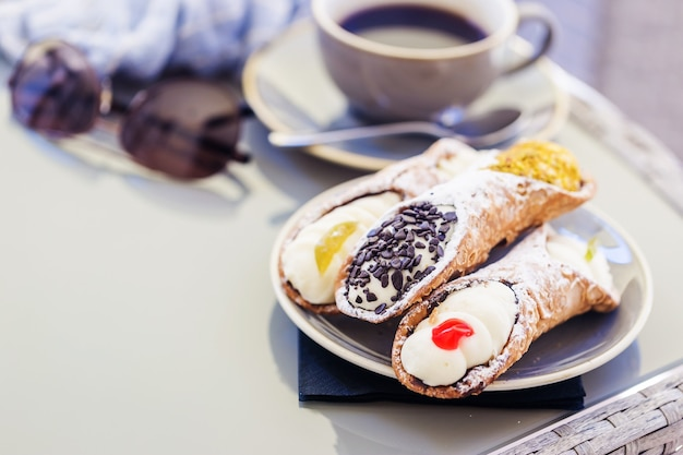 A scrumptious plate of sicilian cannoli with chocolate chips a yummy treat dessert