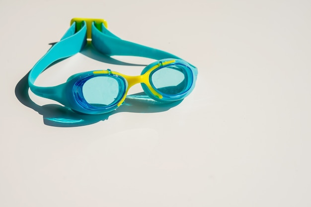 Scuba goggles with breathing tube on isolated white background