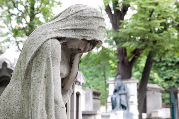 Sculpture crying at the cemetery