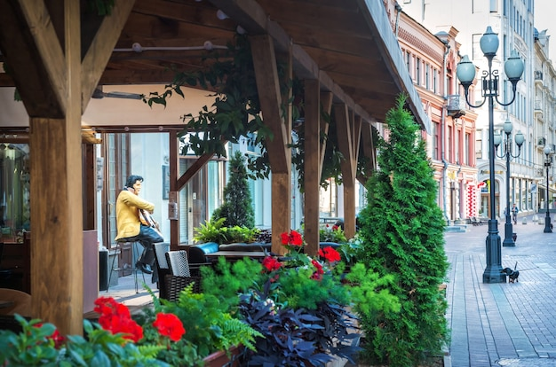 A sculpture of elvis presley at the veranda of a cafe on the arbat in moscow on a summer morning