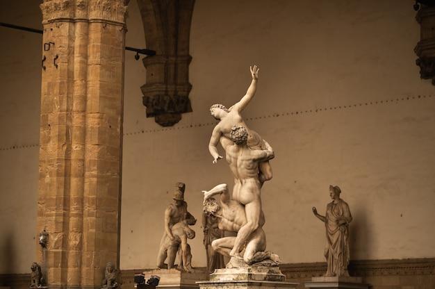 Sculpture of loggia dei lanzi and florence palazzo vecchio on piazza della signoria in florence, italy. architecture and landmark of florence.