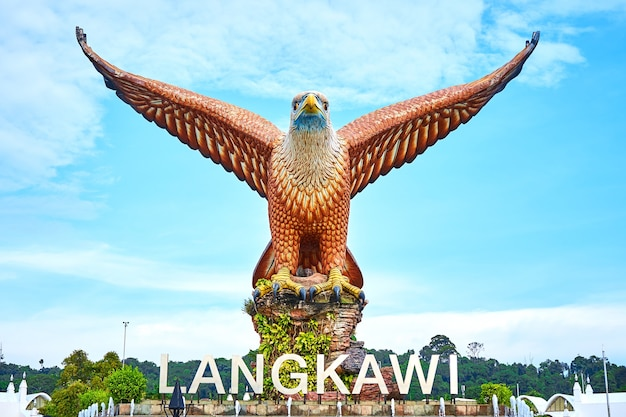 A sculpture of a red eagle spreading its wings. popular tourist spot on langkawi island. langkawi, malaysia - 07.18.2020