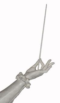 Скульптура каменная рука дирижера с палкой, изолирована.