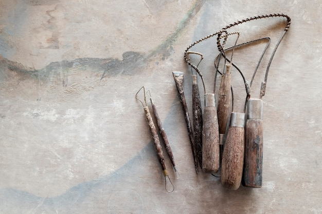 Sculpture tools. art and craft tools on vintage wood background. close-up.