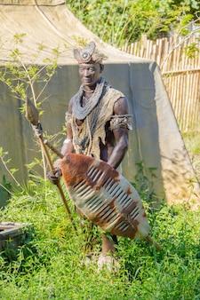 Sculpture of a warrior in the savannah in biopark in rio de janeiro, brazil - july 11, 2021: sculpture of a warrior outdoors in biopark in rio de janeiro.