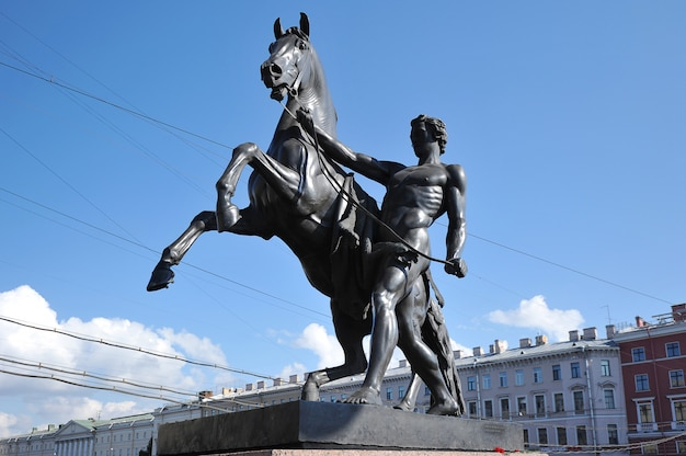 Sculpture with a horse on the anichkov bridge in st. petersburg