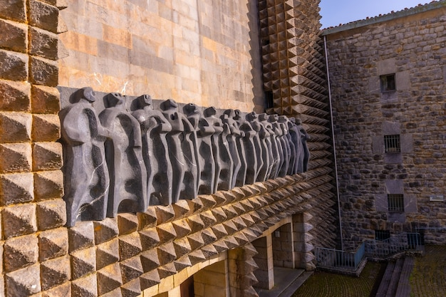 Sculptures of the precious aranzazu sanctuary in the town of oati, gipuzkoa. emblematic sites of the basque country, vertical photo