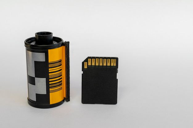 Sd card for digital camera next to an old film.