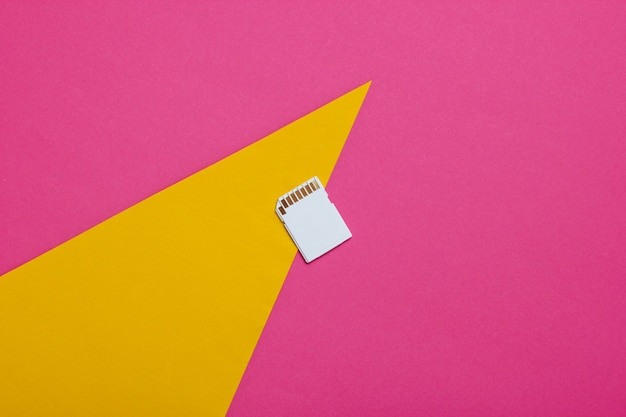 Sd memory card on a colored paper with geometric shapes