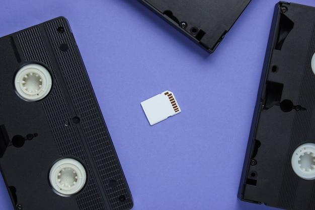 Sd memory card, video cassette on purple paper