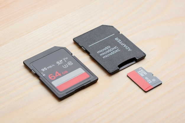 Sd and micro sd card with adapter on wooden table