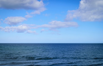 Sea and blue sky with cloud background