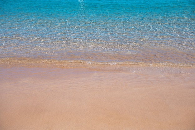 Sea background nature of tropical summer beach with rays of sun light sand beach sea water with copy...