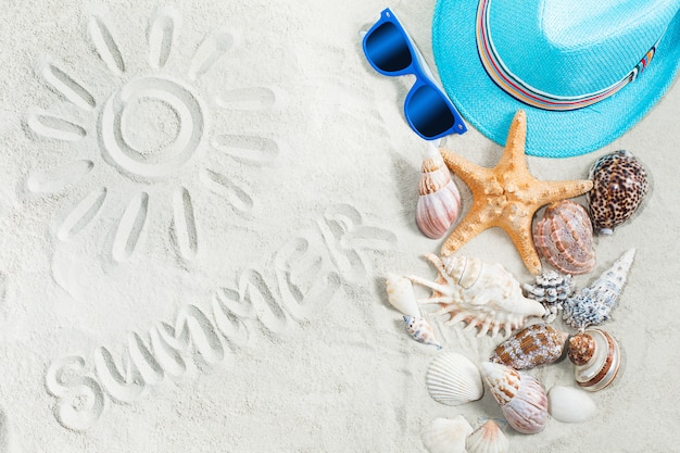 Sea background. picture of a sun on a white sand. child`s clothes flat still top-veiw