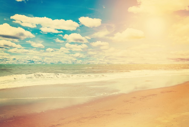 Sea and beach in summer in vintage effect.