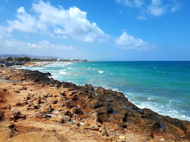 Sea and beach with blue sky in agios nikolaos