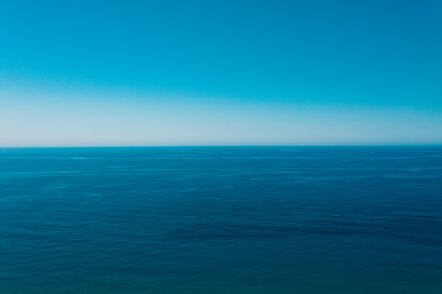 Sea and blue sky background.