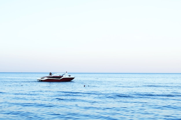 Sea boat in the distance, beautiful blue sea in summer, space for text