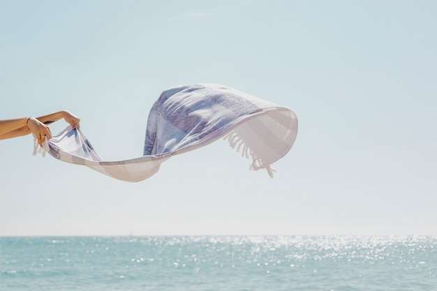 Sea breeze blowing the stripes scarf