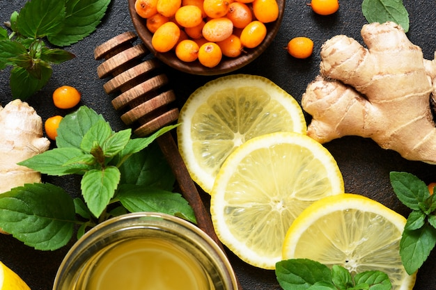 Sea buckthorn drink. tea with lemon and honey. ingredients for making tea.