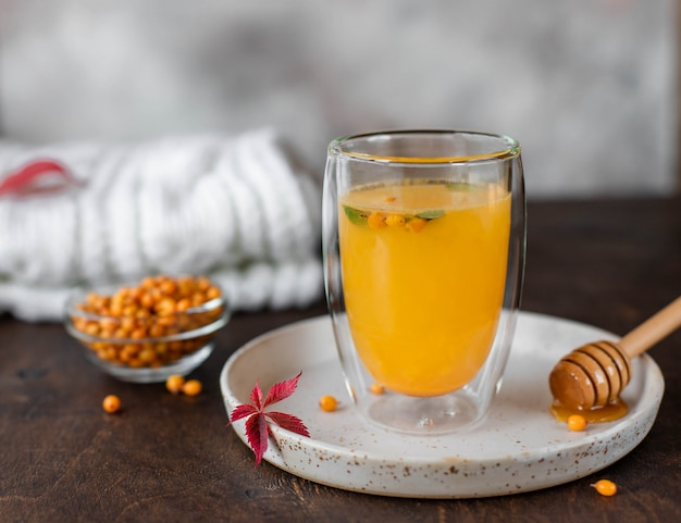 Sea buckthorn hot tea with mint and honey. herbal vitamin tea, close-up