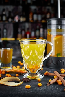 Sea buckthorn tea on a dark background