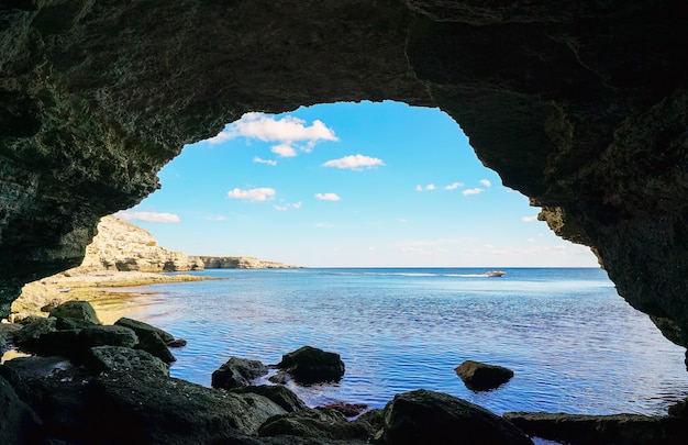 Sea cave in the rock overlooking the sea .
