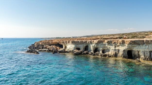 Sea caves near ayia napa and protaras. cavo greco, cyprus island, mediterranean sea.