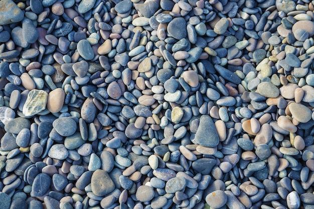 背景、海の石のテクスチャの海色の小石