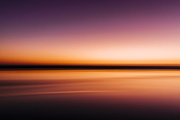 Sea during a colorful sunset with a long exposure