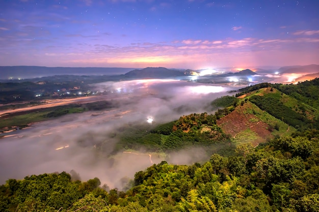 The sea of fog at sunrise can see the laos side of the mekong river in nong khai province, thailand