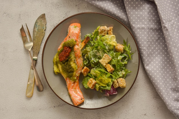 Sea food. baked salmon and healthy salad. top view. healthy food.