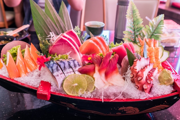Sea food set with mix fish and squid shellfish on ice. original or tradition japanese food
