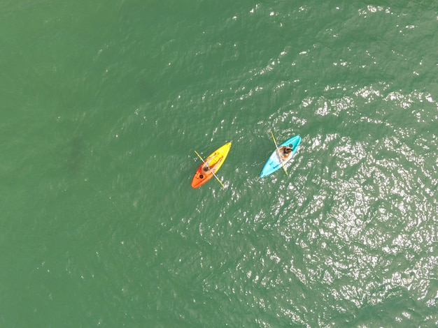 Sea kayaking together on the emerald green sea
