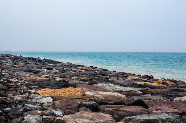 Sea landscape, rocks, sea and blue sky