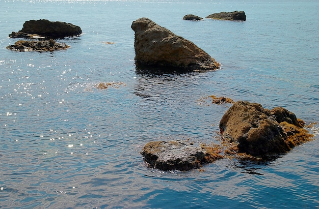 Sea landscape with rocks and water surface.
