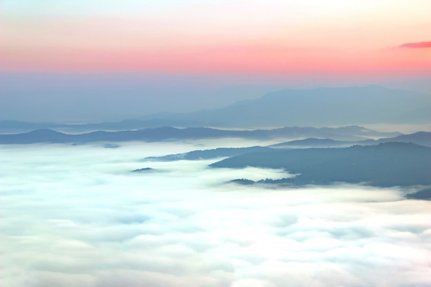 Sea of mist on the top of mountain during sunrise at sri nan national park, nan thailand.